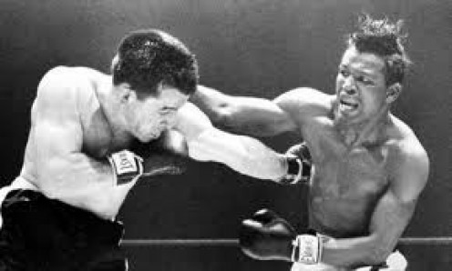 Sugar Ray Robinson knocked out Rocky Graziano in three rounds in defense of his middleweight championship.