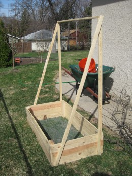 Here is a container with a built on frame that would be perfect for growing cucumbers or pole beans. This is a great ideal for vertical gardening.