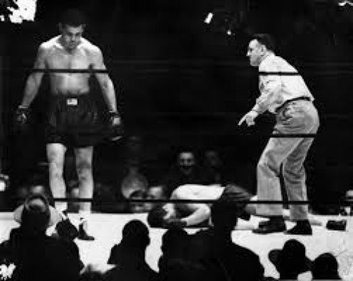Joe Louis knocked James J. Braddock out in the 8th round to win the heavyweight crown and begin his record breaking title run.,