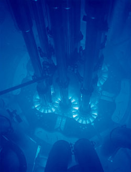 Cherenkov radiation is emitted when charged subatomic particles are moving faster than light within a material.