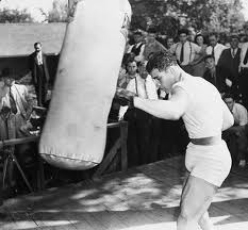Joe Louis is seen here blasting out the heavy bag.