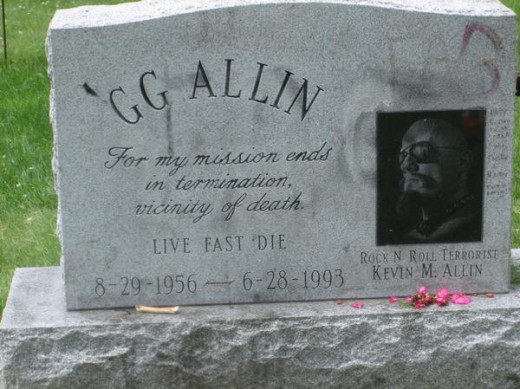 GG Allin's grave marker at Saint Rose of Lima New Catholic Cemetery in Littleton, NH.  Notice the remnants of erased graffiti.