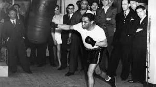 Henry Armstrong is seen here working out on the heavy bag.