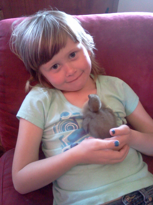Alana doing one of her most favorite things in the world to do...loving on her one of her animals.