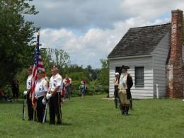 Flag retiring in front of surveyor's house.