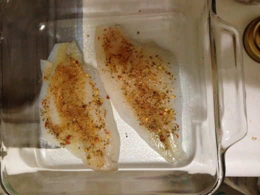 Sprinkle the spices, in this case garlic garni, over the flourer