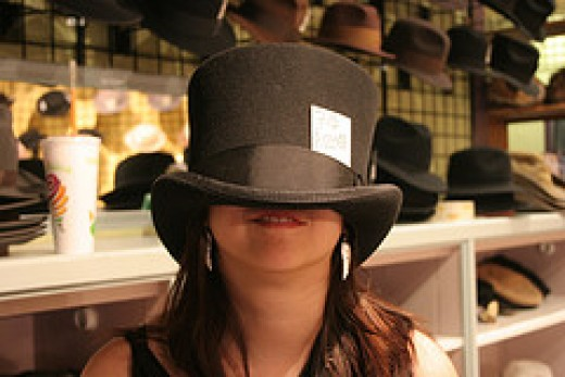 Trying on hats by cackhanded/flickr