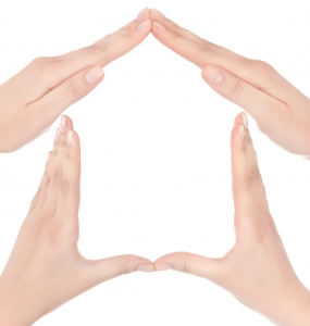 The walls and roof of a house in hand made symbols