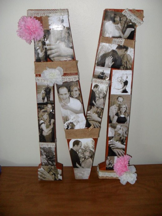 Homemade decor, pictures of the happy couple mod podged onto the first letter of their last name.