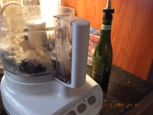 Attach the lid to your food processor and start the machine. Drizzle the 2/3 cup oil in through the food chute.