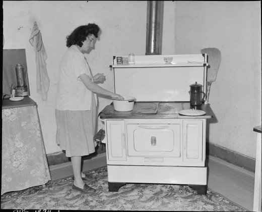Woman at stove c. 1945