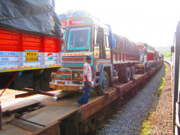Trucks are being ferried. It is cost efficient and saves on  fuel consumption.  It is called RoRo Service.