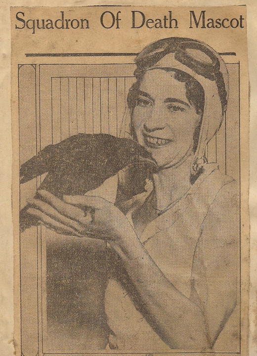 """Frankie Renner, the president of the Squadron of Death, holding """"Soddie"""", the girls' mascot."""