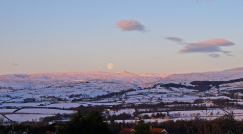 Moon at Sunrise View over Beith to the Kilbirnie Hills. The highest hill is Black law and the deep valley is cut by the Garnock River. Viewed from Roebank Road Beith.