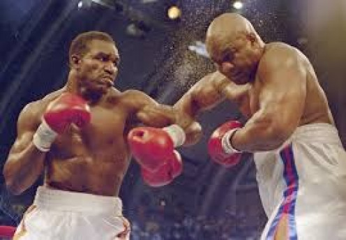 Evander Holyfield beat Big George Foreman by12 round decision in 1991 in defense of his heavyweight championships.