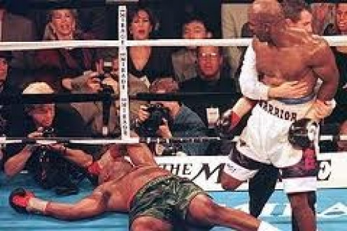 Evander Holyfied unified heavyweight titles and avenged an early career defeat by knocking M chapel Moorer out.