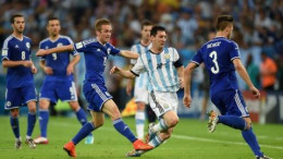 Lionel Messi marked by a group in the FIFA world cup 2014 match against Bosnia