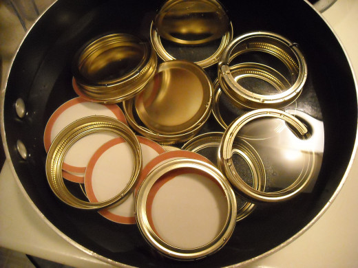 Lid and rings in hot water.