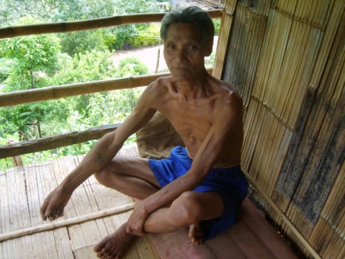 Hii Tribe man relaxing in his house avoiding the heat of the midday sun