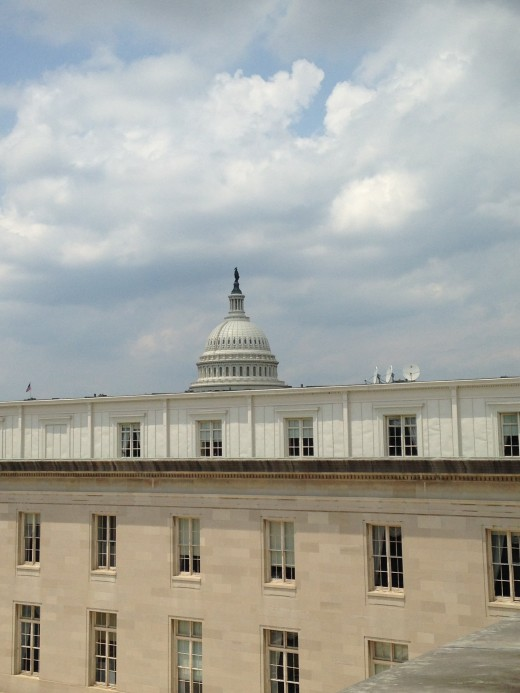VIEW OF THE CAPITOL DOME STANDING ON THE 3'-WIDE BALCONY OUTSIDE CONGRESSMAN YOHO'S CANNON OFFICE BUILDING'S 5TH FLOOR WINDOW (the floor with the smallest offices since he is a first term representative.)