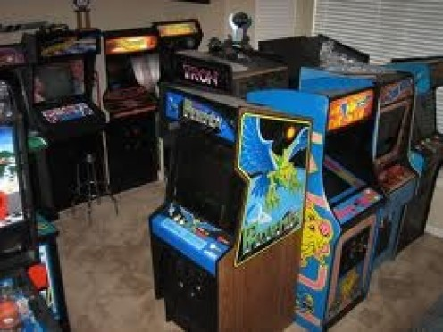 Arcade games adorn the bowling alley and they have many types of games to choose from for kids and adults.