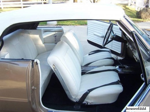 The 64 GTO interior had the look and feel of a race car. It sported stylish bucket seats, an aluminum instrument panel, a custom steering wheel and a shifter in the console.