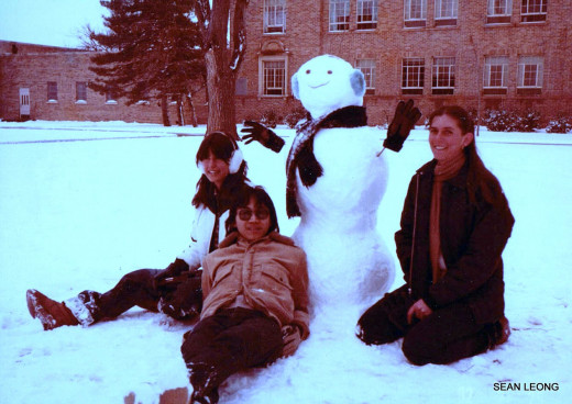 Ana on the left and Penny on the right. They made a snow man outside their dorm.