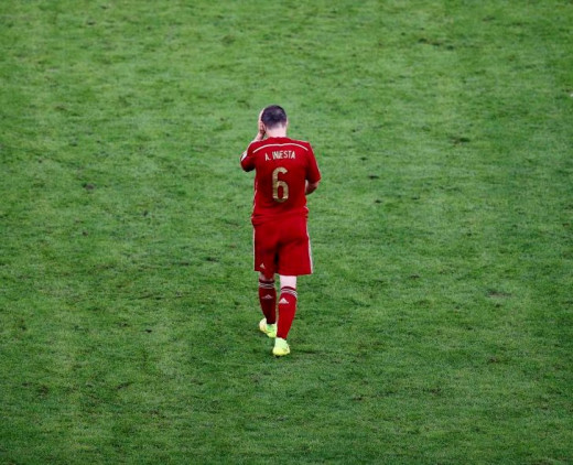 Disappointed Andre Iniesta after the first round elimination of Spain from FIFA world Cup 2014
