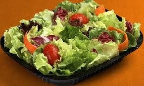 A simple salad with lettuce, tomatoes and carrots is a delicious treat to serve to your guests just before the main course is ready.