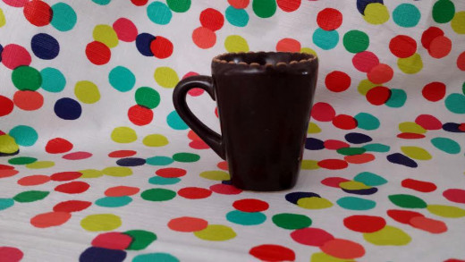 I used my tablecloth to photograph this mug.  Tablecloths are easy to use since they can be cleaned easily and spread out easily.  They are usually large enough to take pictures of different sized objects.