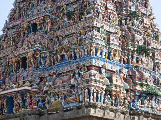 Closer view of a Gopuram showing colourful sculptures.
