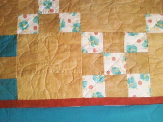 A forties' fabric set in a near-solid, golden brown featuring my hand quilting.