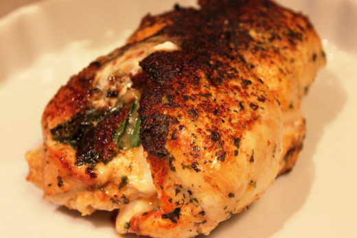 Jerk chicken stuffed with spinach and provolone cheese. Copyright 2014 Bill Yovino