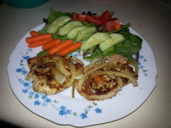 Pan seared Pork Chops with sauteed Onions and Salad