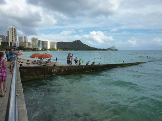 One of the best places in the world to stand is this wall in Waikiki.