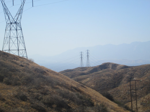 Pylons on the hills with the San Bernardino Mountains in the background.