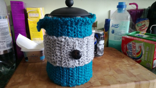 A cafetiere in a cosy