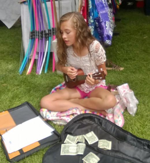 Mia plays her ukelele