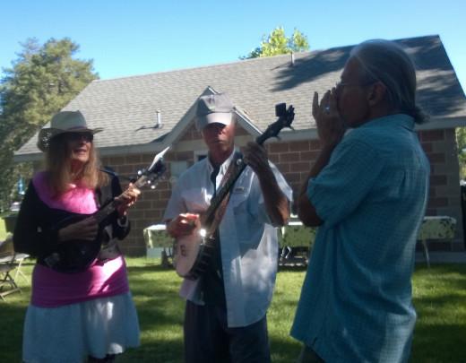 Gloria, Max and Grant perform bluegrass