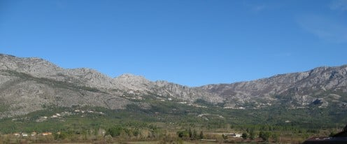 Gray mountains surrounds  the  village.