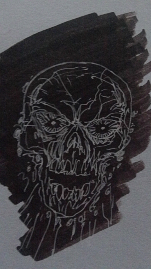 A skull drawn with sakura white gelly roll pen on black marker
