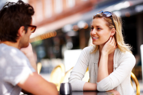 Talk to your date. Image of a woman and man talking