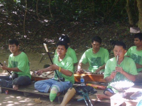 Landmine victims play music to raise money for further medical treatment.