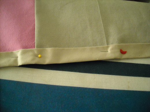 Fold up in half once, then in half again. Press and pin.