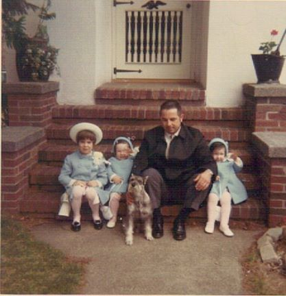 My grandfather with my my mother (far left) and my twin aunts.