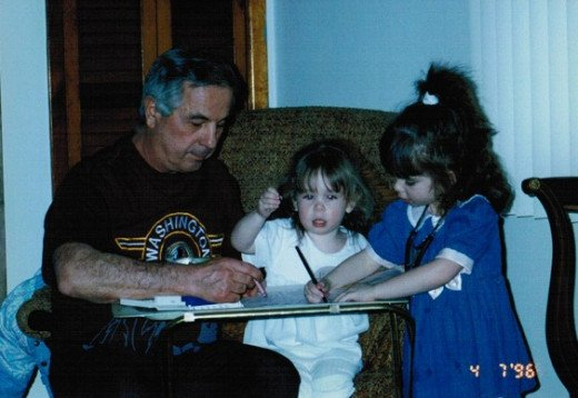 My grandfather on the left with my sister (middle) and me (right)