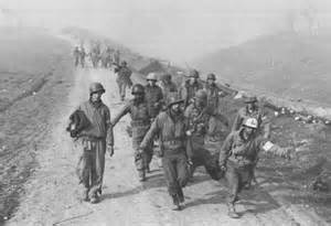 Medics hauling 36th ID casualties from the Rapido River crossing.