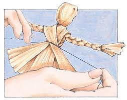 Tie the waist with string and cover with a narrow cornhusk. Trim the skirt so she can stand up. Glue on corn silk for hair, and make a bonnet out of a husk.