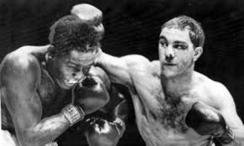 Rocky Marciano, right, seen here beating Ezzard Charles is the only undefeated heavyweight champion in history.
