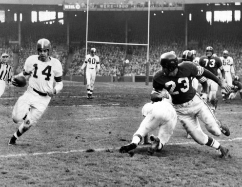 Number 14 Otto Graham is seen here schooling the competition. He knew the game and was a true team leader.